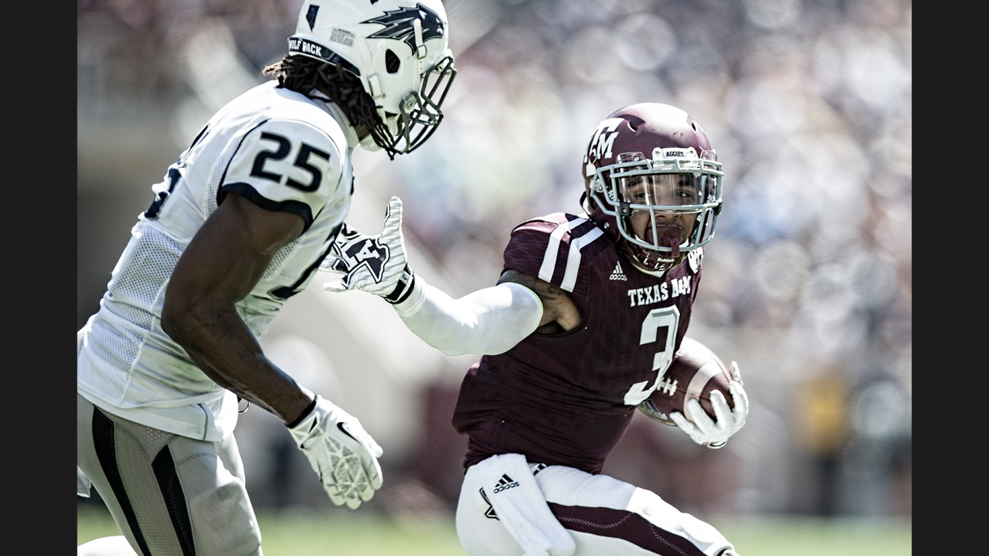 Five-star freshman WR Christian Kirk looks to get around a Nevada defender during the Aggies' win. Kirk, who, like Allen, is originally from the Phoenix area, has become a favorite target early in the season.