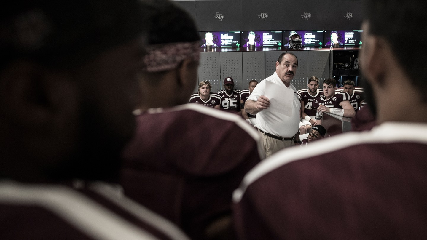 Defensive coordinator John Chavis addresses his team with changes and challenges at halftime of the game against Ball State.
