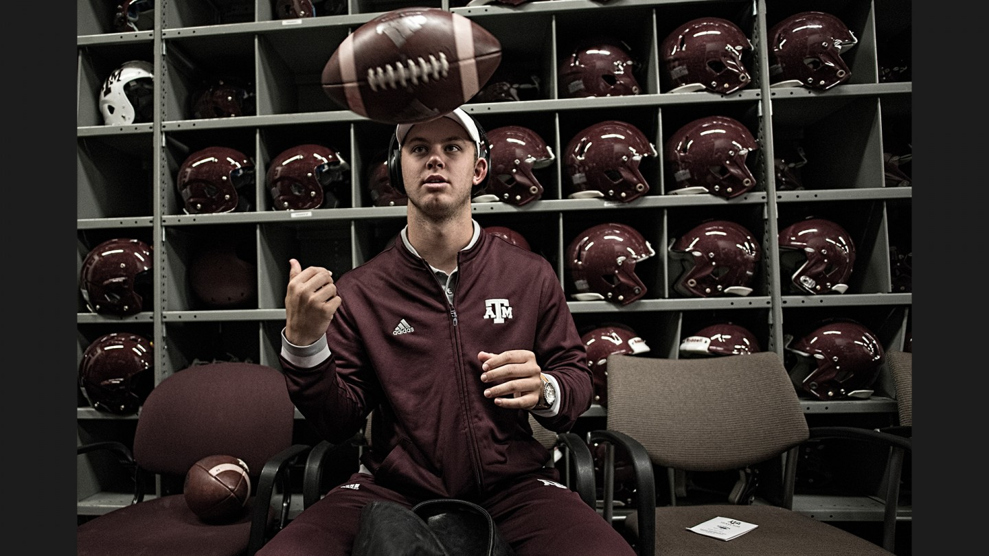 Quarterback Kyle Allen checks the game balls in the equipment room with the staff before pregame warmups.