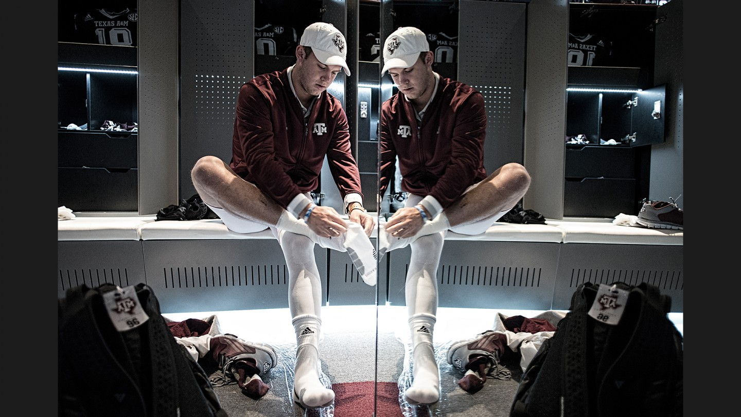 Kyle Allen suits up in the locker room before taking the field for warmups.