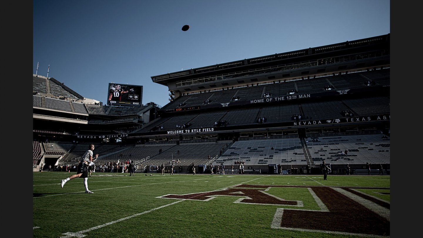 Kyle Allen warms up on the field with some long throws before the Aggies' win over Nevada. Allen would throw for 270 yards and four touchdowns.