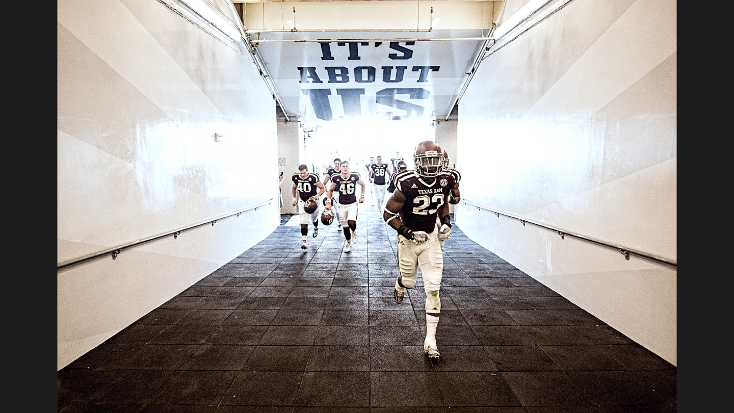 Texas A&M players head to the locker room for halftime.