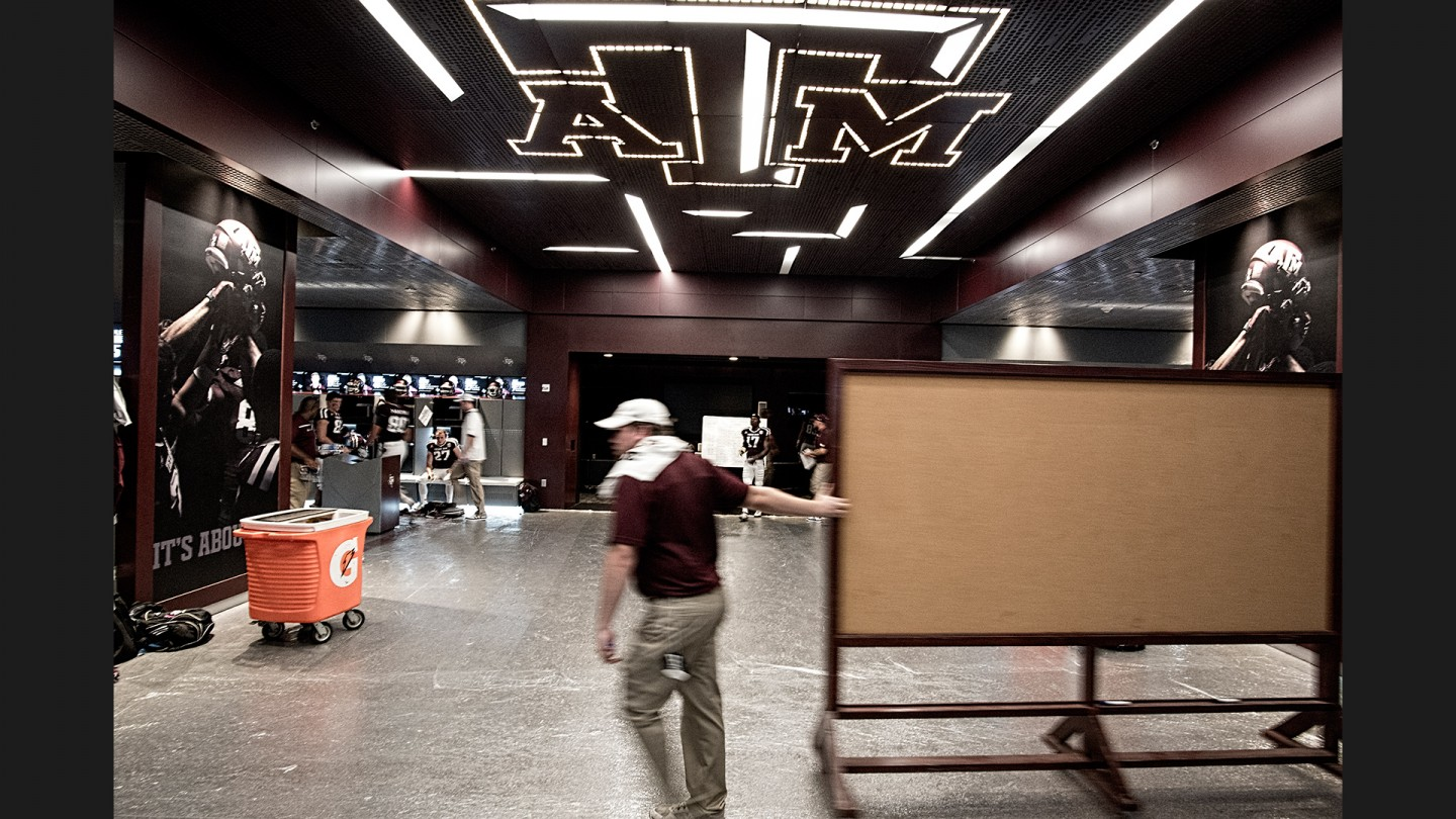 Aggie equipment personnel and coaches prepare for halftime discussions during the Aggies' win over Nevada.
