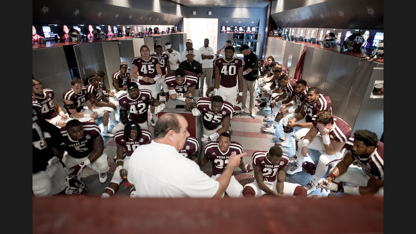 Defensive coordinator John Chavis goes over halftime adjustments with his players and coaches before the start of the second half.