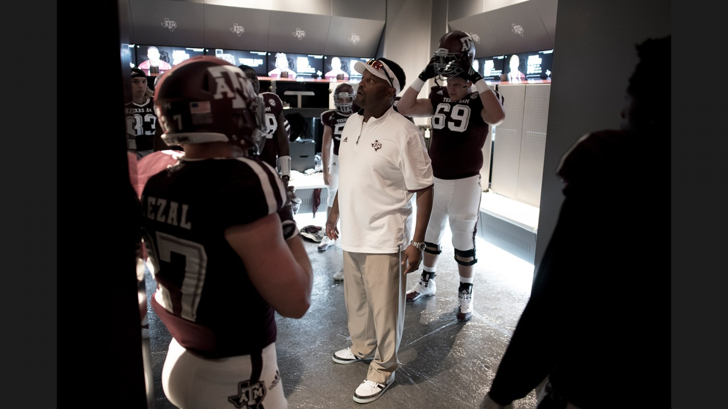 Coach Kevin Sumlin gathers his players in the locker room before the start of the second half against Nevada.