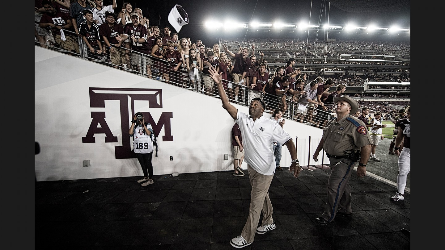 Coach Kevin Sumlin tosses his visor into the crowd as he exits the field following the Aggies' win over Ball State.