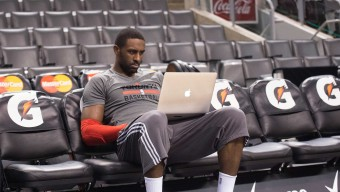 Jan 12, 2015; Toronto, Ontario, CAN; Toronto Raptors forward Patrick Patterson (54) looks at a computer during the warm-up before a game against the Detroit Pistons at Air Canada Centre. Mandatory Credit: Nick Turchiaro-USA TODAY Sports