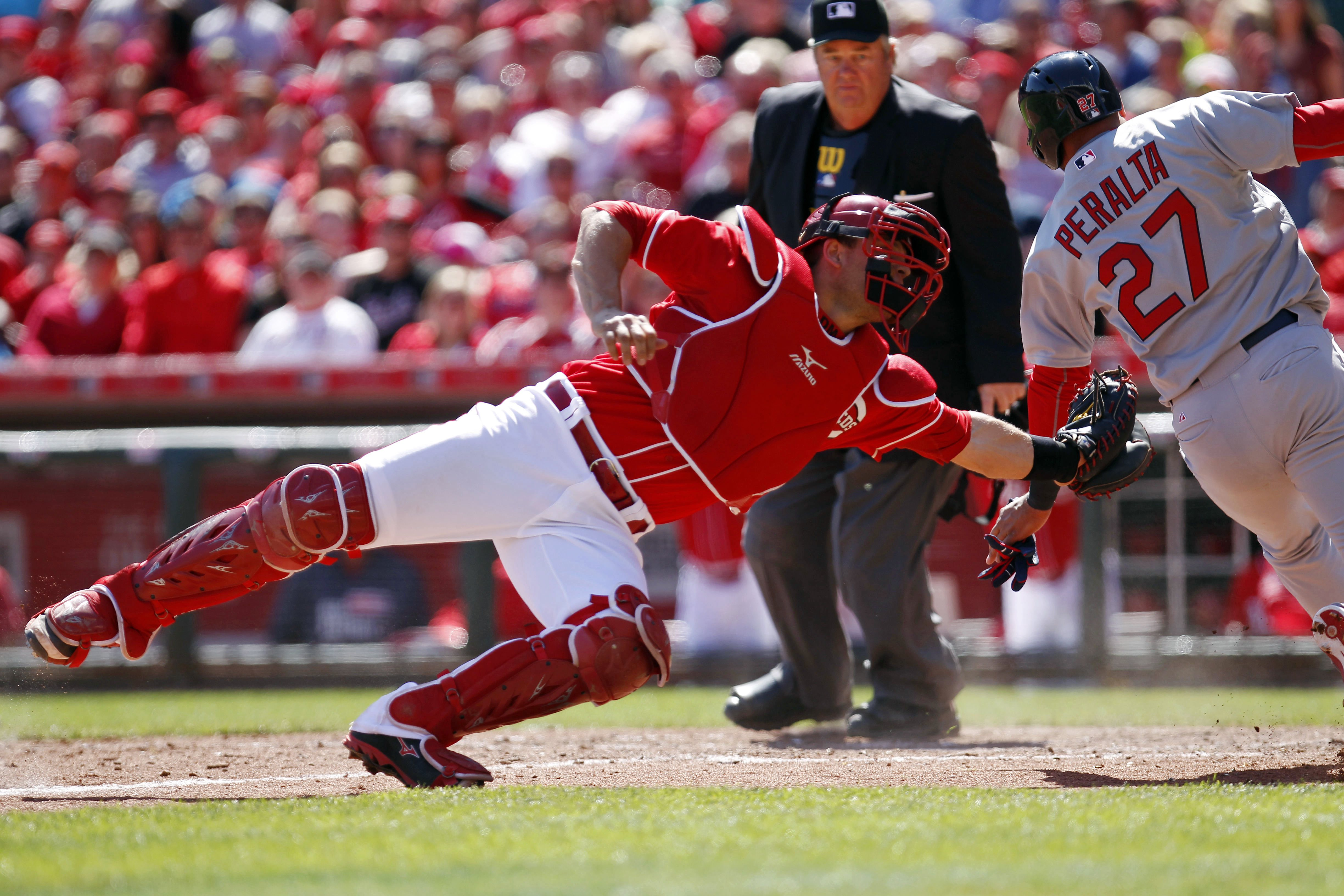Apr 11, 2015; Cincinnati, OH, USA; St. Louis Cardinals shortstop Jhonny Peralta (27) scores during the ninth  inning against the Cincinnati Reds catcher Devin Mesoraco (39) at Great American Ball Park. The Cardinals won 4-1. Mandatory Credit: Frank Victores-USA TODAY Sports