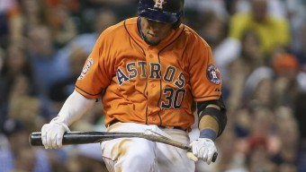 Aug 14, 2015; Houston, TX, USA; Houston Astros center fielder Carlos Gomez (30) breaks a bat on his leg after striking out during the eighth inning against the Detroit Tigers at Minute Maid Park. Mandatory Credit: Troy Taormina-USA TODAY Sports