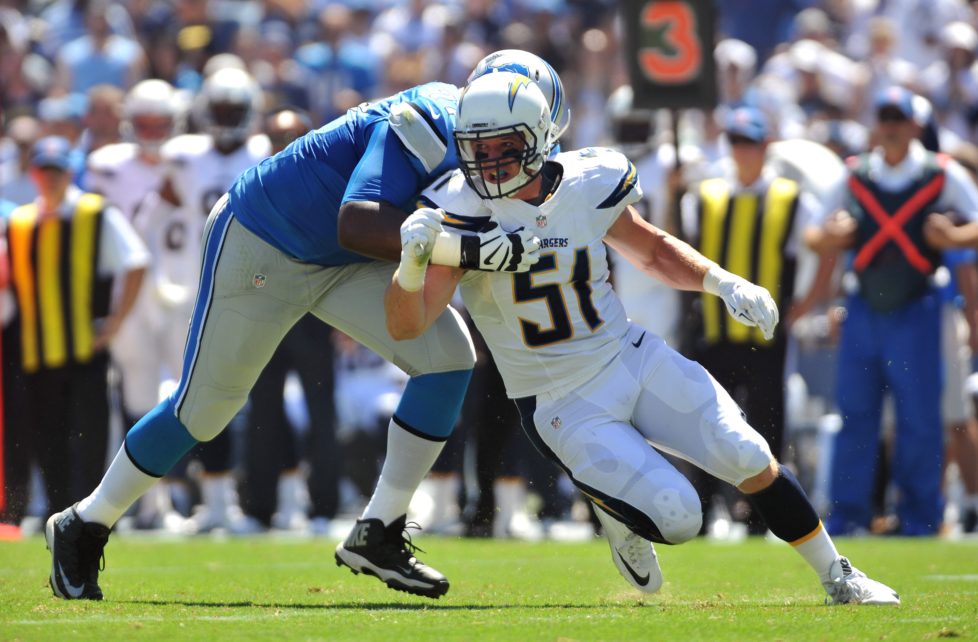 Sep 13, 2015; San Diego, CA, USA; San Diego Chargers linebacker Kyle Emanuel (51) is defended by Detroit Lions tackle Cornelius Lucas (77) during the game at Qualcomm Stadium. San Diego won 33-28. Mandatory Credit: Orlando Ramirez-USA TODAY Sports