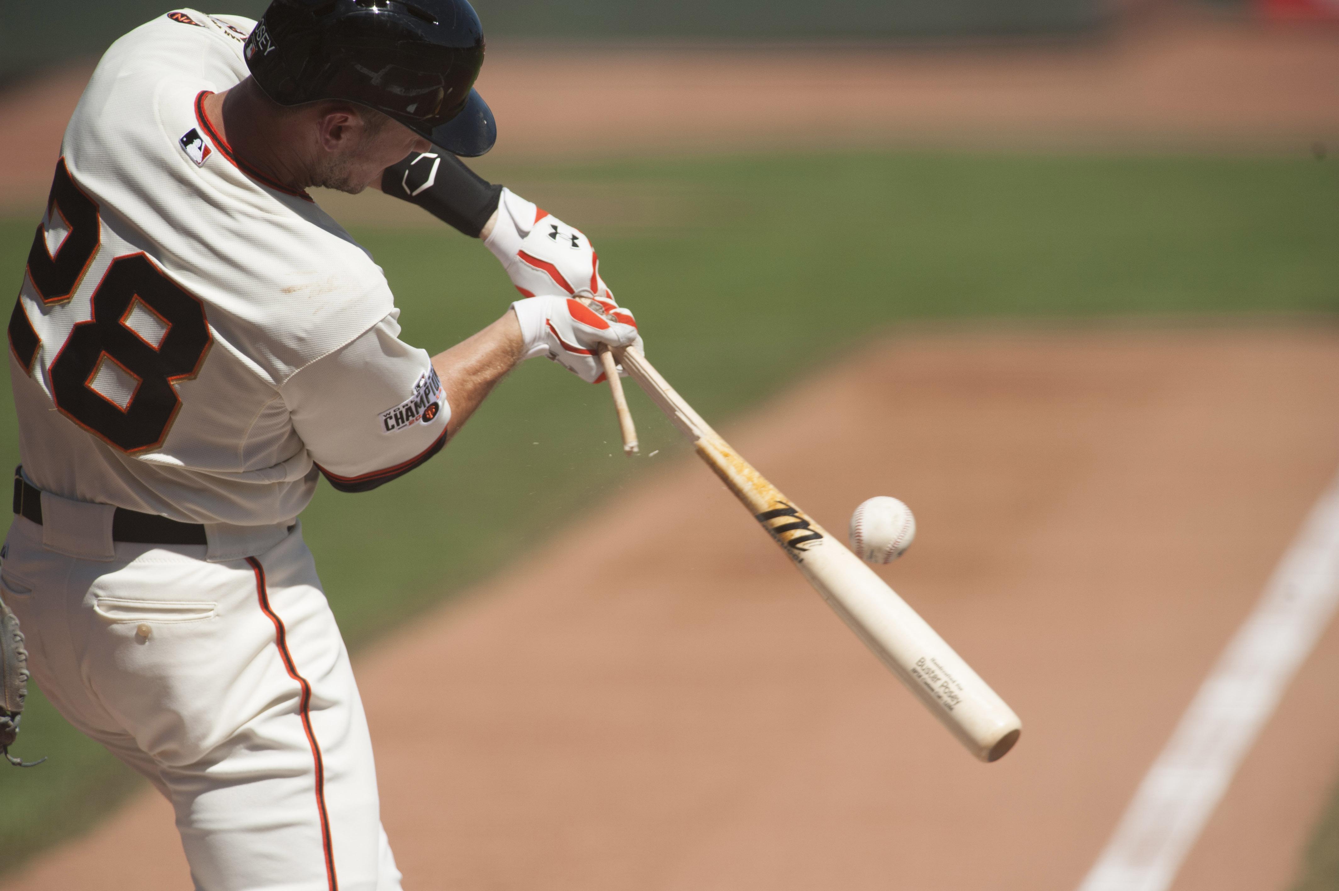 Sep 20, 2015; San Francisco, CA, USA; San Francisco Giants catcher Buster Posey (28) breaks his bat against the Arizona Diamondbacks during the first inning at AT&T Park. Mandatory Credit: Ed Szczepanski-USA TODAY Sports