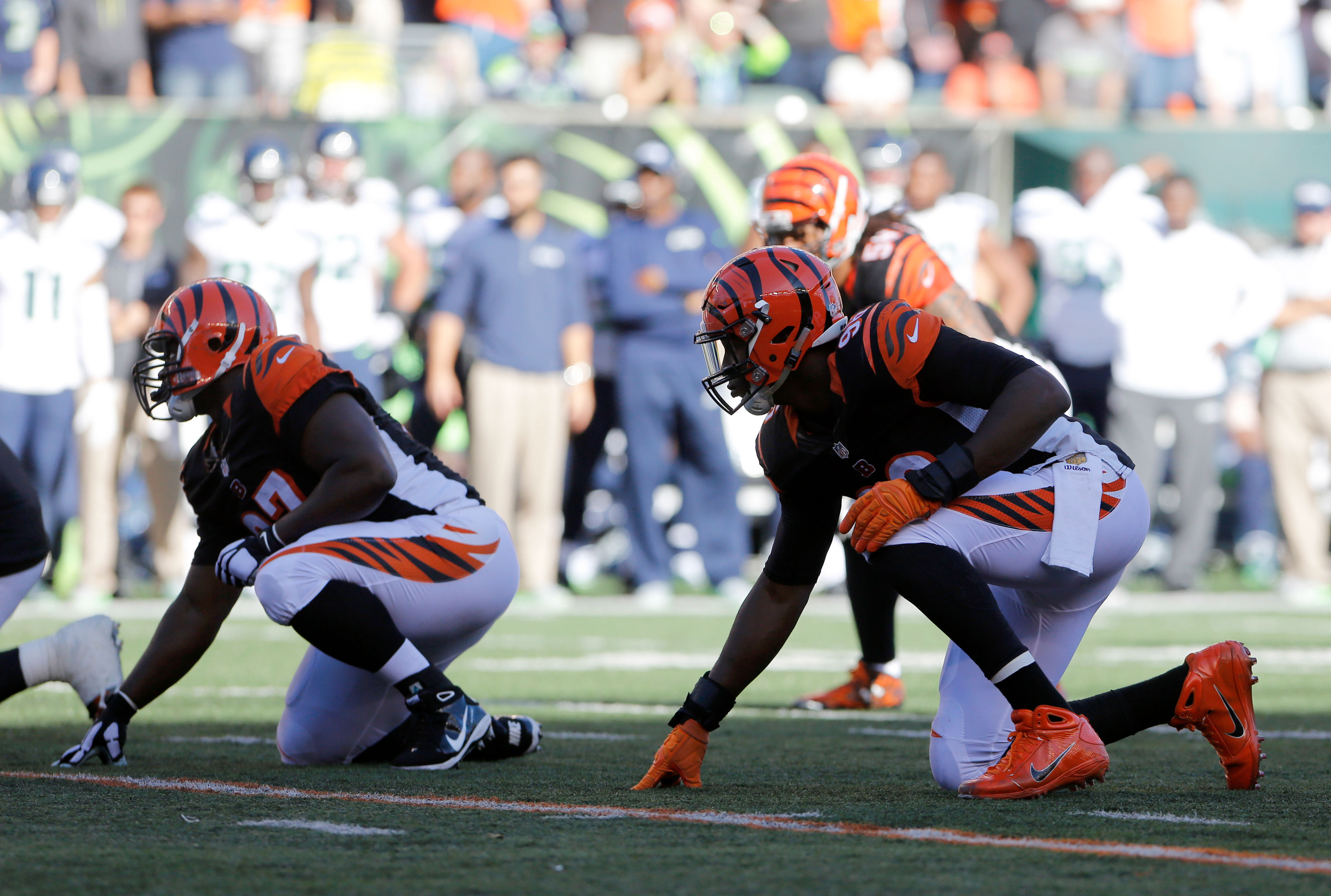 Oct 11, 2015; Cincinnati, OH, USA; Cincinnati Bengals defensive end Carlos Dunlap (96) and linebacker Vincent Rey (57) line up during the game against the Seattle Seahawks at Paul Brown Stadium. Cincinnati defeated Seattle 27-24. Mandatory Credit: Mark Zerof-USA TODAY Sports