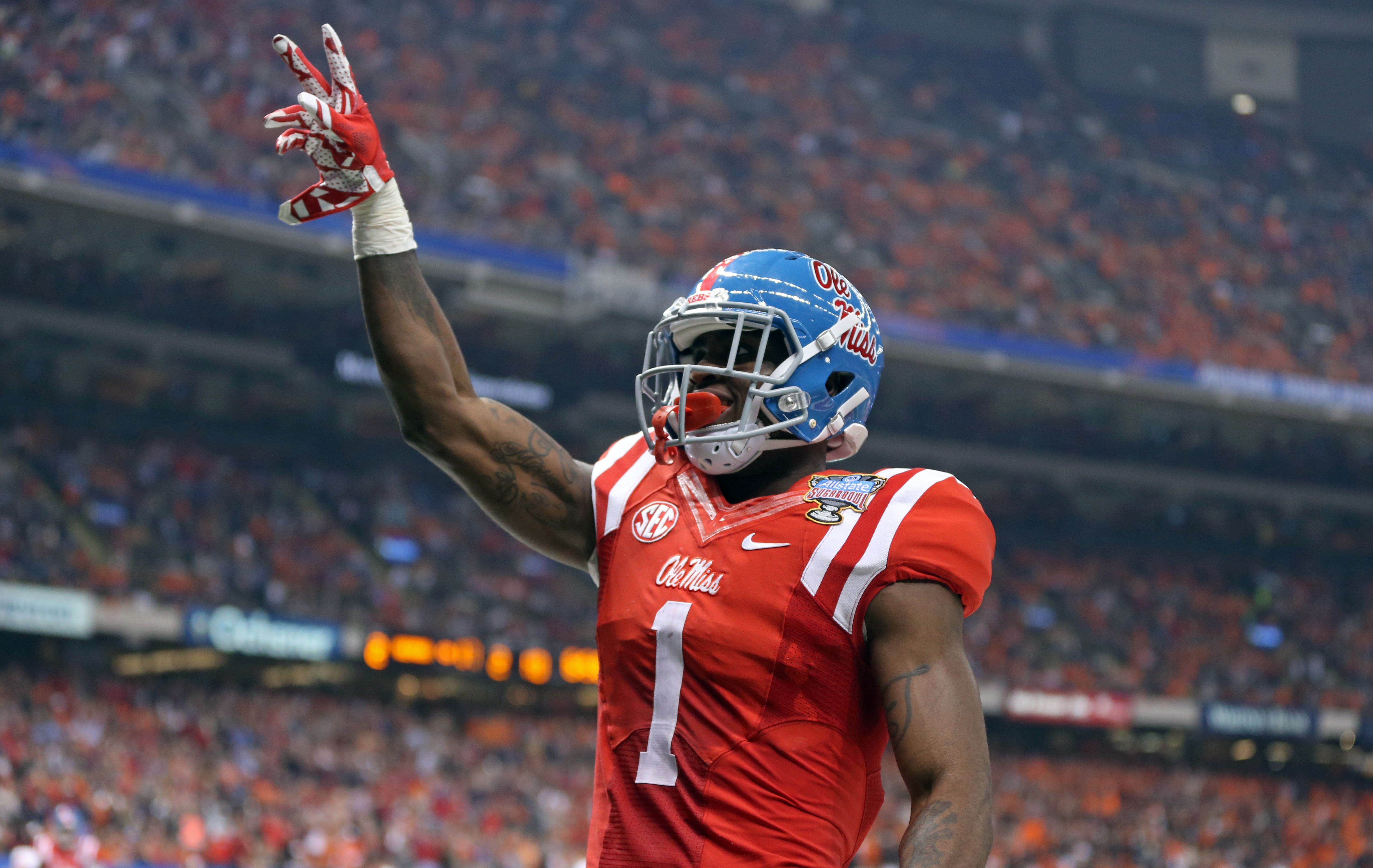 Jan 1, 2016; New Orleans, LA, USA; Mississippi Rebels wide receiver Laquon Treadwell (1) celebrates his ten-yard touchdown catch against the Oklahoma State Cowboys in the second quarter of the 2016 Sugar Bowl at the Mercedes-Benz Superdome. Mandatory Credit: Chuck Cook-USA TODAY Sports