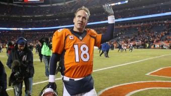 Jan 3, 2016; Denver, CO, USA; Denver Broncos quarterback Peyton Manning (18) waves to the crowd as he walks off the field after the game against the San Diego Chargers at Sports Authority Field at Mile High. The Broncos won 27-20. Mandatory Credit: Chris Humphreys-USA TODAY Sports