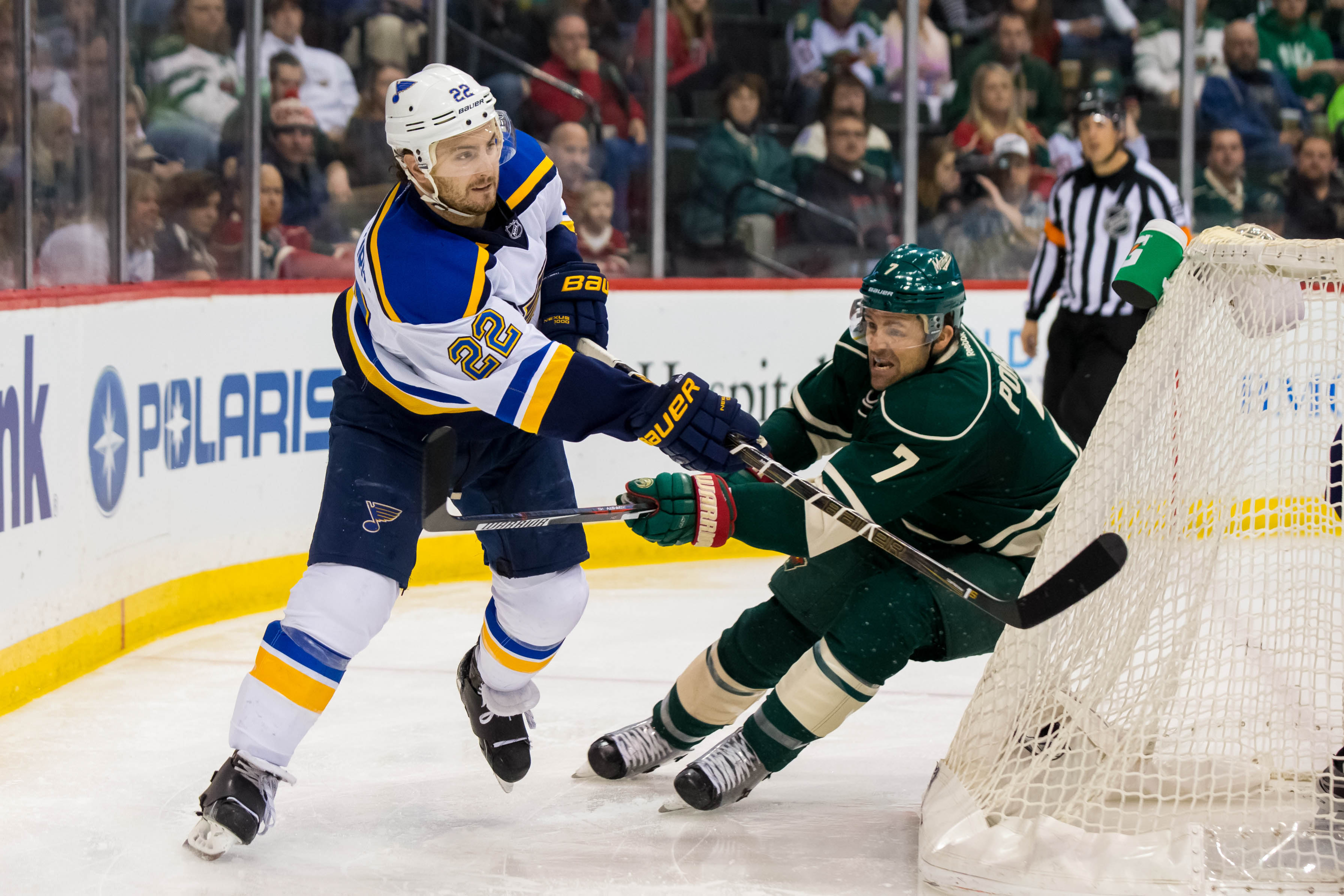 Mar 6, 2016; Saint Paul, MN, USA; St. Louis Blues defenseman Kevin Shattenkirk (22) passes in the second period against the Minnesota Wild forward Chris Porter (7) at Xcel Energy Center. The St. Louis Blues beat the Minnesota Wild 4-2. Mandatory Credit: Brad Rempel-USA TODAY Sports