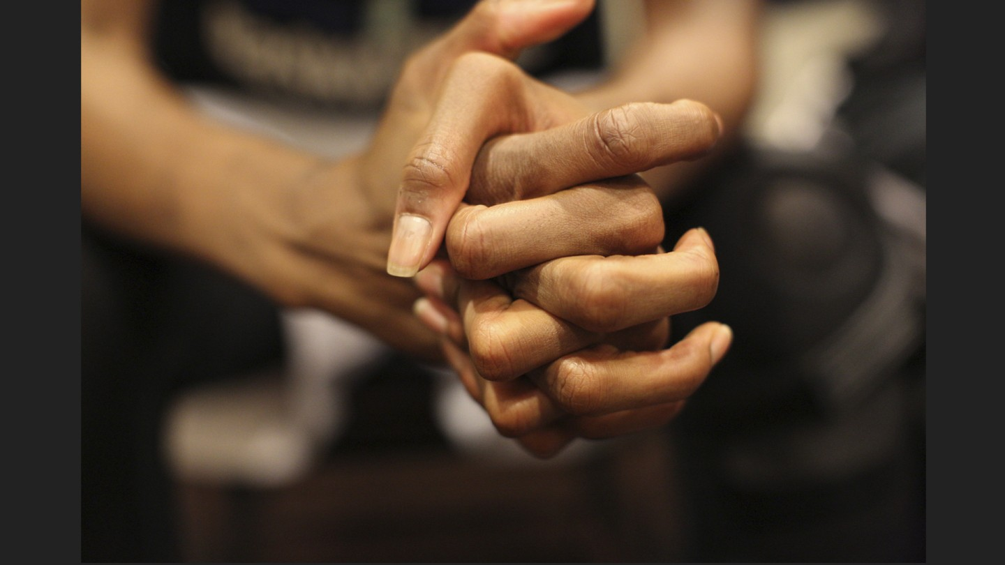 Swin Cash folds her hands to pray during chapel.