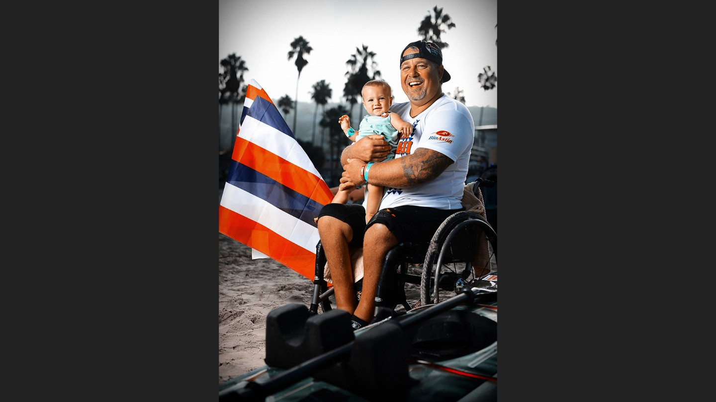 Richard (43) and Malia (8 months) Julian. Richard lost the use of his legs when he was 14....when a drunk driver collided with his car. His girlfriend and sister were killed in the accident. He surfed most of his life, and has adaptive surfed for the past 16.