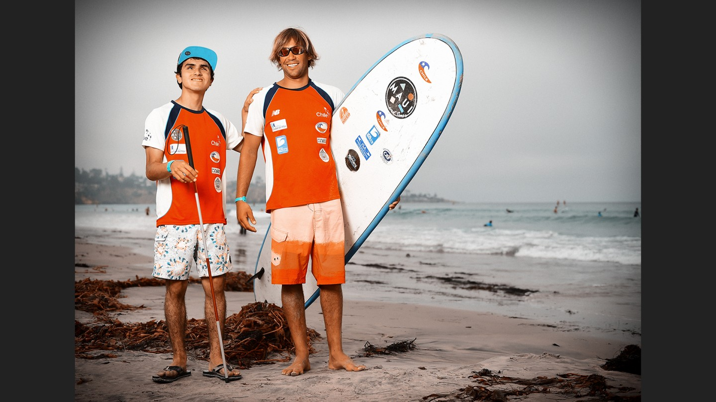 Lucas Retamales (left) is blind. With the help of his coach Andres Valdes he surfs. He's been surfing for 2 years. They represent Chile.