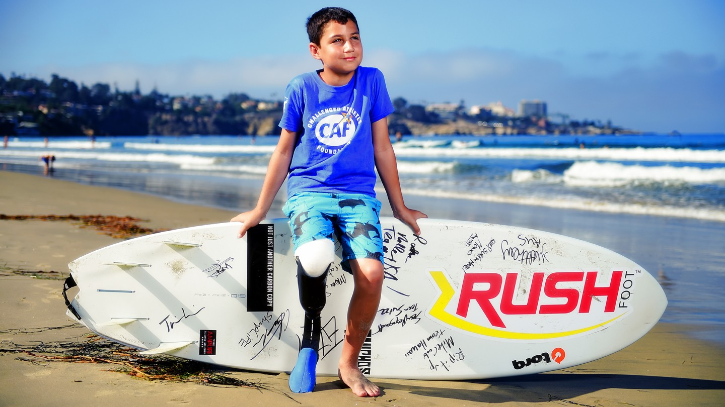 12 year old Adrian Grajeda was struck by a drunk driver while playing during recess at his school in Palm Desert several years ago. He was a spectator at the contest, where the crew gave him a board and he surfed for the first time in his life. He's also a tackle and middle linebacker on his Pop Warner football team.