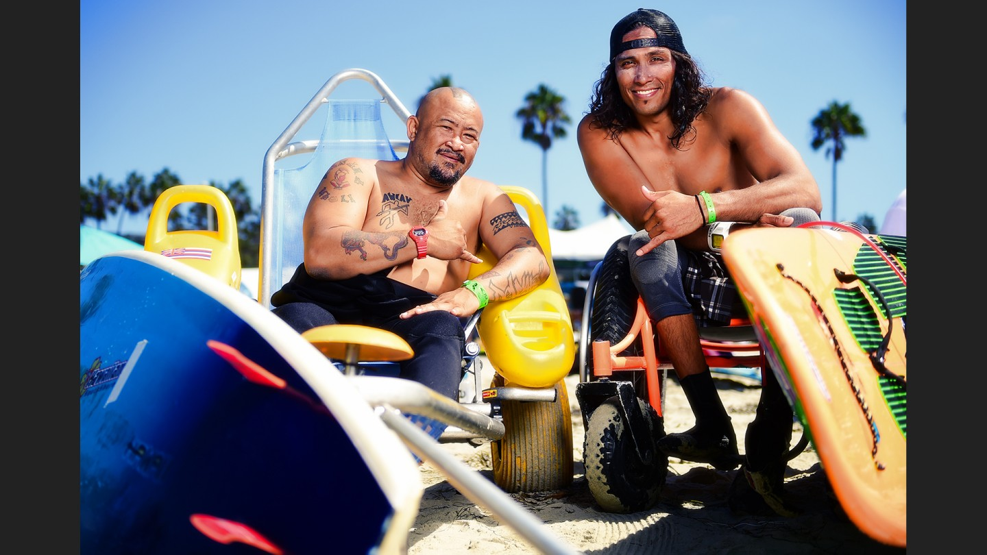 At left, Jesse del Mar III of Hawaii is a 47 year old who has been surfing all of his life. He broke his neck surfing in 1997. At right is 37 year old Hawaiian Zach Tapec, who broke his neck diving into a swimming pool in 1995.