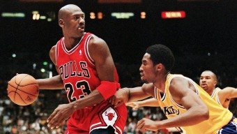 Michael Jordan of the Chicago Bulls (L) eyes the b