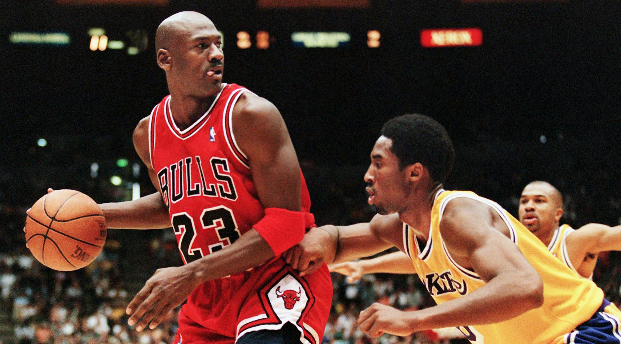 Michael Jordan of the Chicago Bulls (L) eyes the b