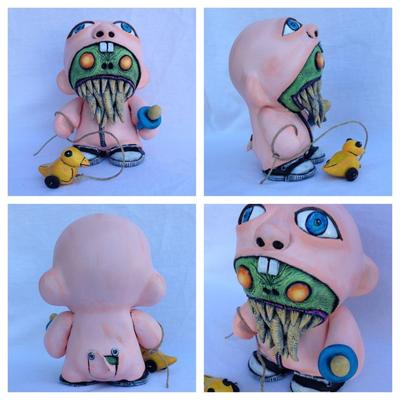 Monster_in_a_baby_suit-davemarkart-munny-trampt-130492m
