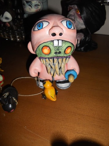Monster_in_a_baby_suit-davemarkart-munny-trampt-130732m