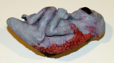 Grey_resin_sculpture-small_angry_monster_adam_pratt-grey-trampt-163161m