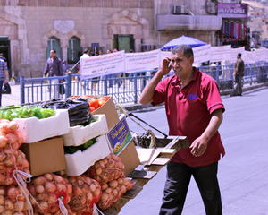 Vendor outside King Hussein Mosque