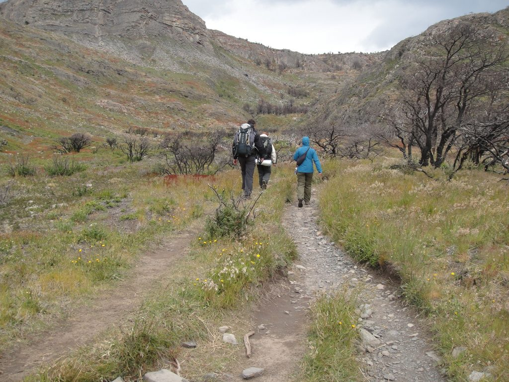 hikers marking own trail torres del paine