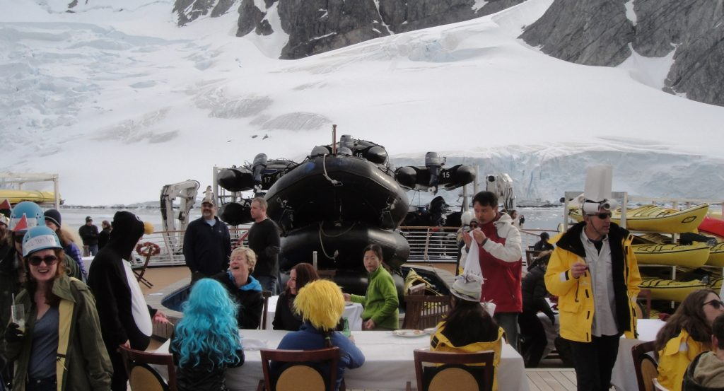 hat competition and bbq on deck in antarctica