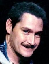 Mark E. Cain