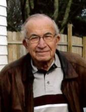 John E. Backensto