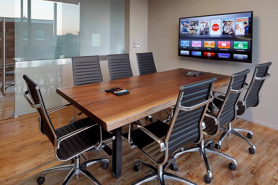 Larger meeting rooms give team members more space to work, and each room has an Apple TV that allows screen sharing for more collaboration.
