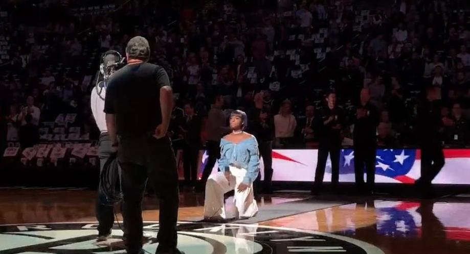 Singer Kneels While Performing National Anthem