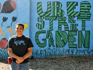 Engineers Without Borders Project leader Torin Johnson stands in front of the Uber Street Garden Mural on Sept. 27. Jenny Kerrigan TTN