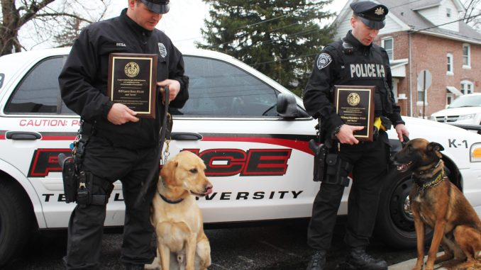 Temple Police Officer Larry Besa (left) stands with his dog Jarvis next to Officer Doug Hotchkiss and his dog Baron. | Claire Sasko TTN