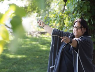 Jessica Castro, a practicing Wiccan, uses an athame and wand to channel energy in nature. | Margo Reed TTN