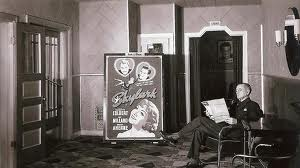 Charles Spainhour sits in the Twilight Theatre lobby. The year was 1941.