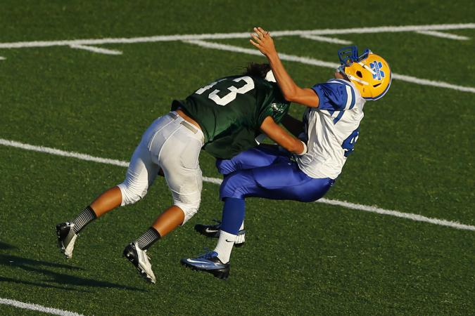 Football_player_getting_rocked