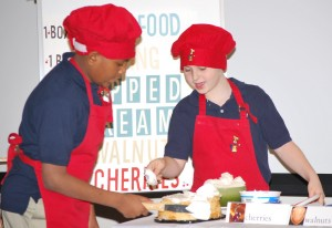 Two youth doing a baking demonstration