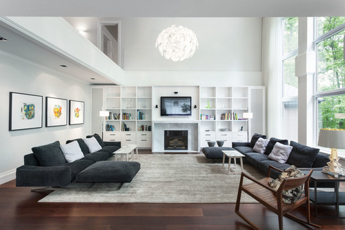 http://s3.amazonaws.com/unlistedproperty/images/images/000/000/001/thumb/nice-white-room-with-black-furniture-with-ahite-TV-cabinet-also-wooden-burning-fireplace-then-black-pabric-sofa-with-white-and-black-pillows-then-awesome-chandelier..jpg?1462400287