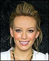 Hilary Duff slicks back her hair.