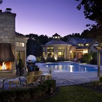 Cozy lighting, custom stonework and a fully equipped gazebo  make this the ideal spot to spend your summer nights.