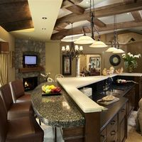 A granite side bar becomes the perfect place for family and friends to gather in your new kitchen.