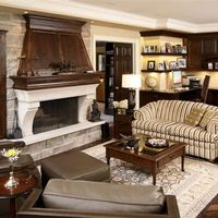 Classic and organized, this family room invites you to read a book by the fire while the kids complete their homework.