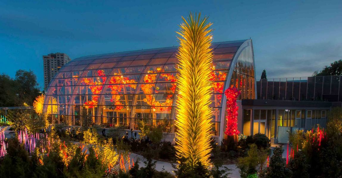 the exterior of chihuly garden and glass in seattle as pictured on its website - Glass Garden Seattle