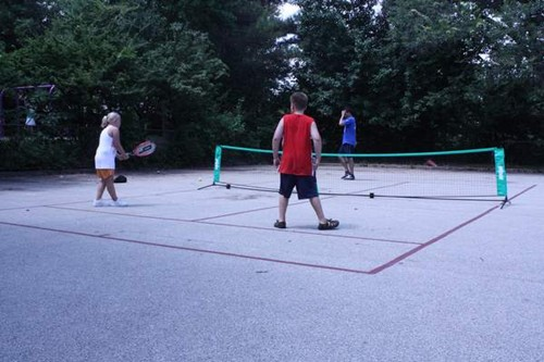 One 36' tennis court on a home driveway.