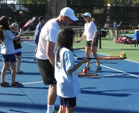 Denis Kudla with Sacred Hearts Student